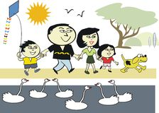 Asian family in park cartoon Stock Photo