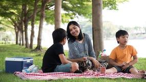 Asian family picnic Royalty Free Stock Photo