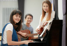 Asian family play music together Stock Photo