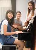 Asian family play music together Royalty Free Stock Photos