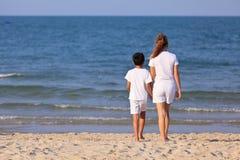 Asian family play sand on beach Stock Photos