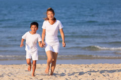 Asian family play sand on beach Royalty Free Stock Photography