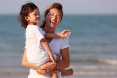 Asian family play sand on beach Stock Image