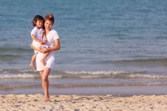 Asian family play sand on beach. Asian family play on tropical beach Royalty Free Stock Photos