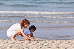 Asian family play sand on beach Stock Photo