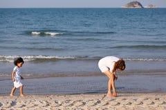 Asian family play sand on beach Stock Photography