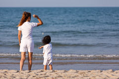 Asian family play sand on beach Stock Photos
