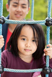 Asian family on a playground Royalty Free Stock Image