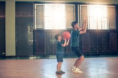 Asian family playing basketball together. Happy family spending free time together on holiday stock images
