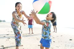 Asian family playing at the beach stock images
