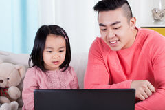 Asian family playing on computer. Asian family during playing on computer, horizontal Royalty Free Stock Images