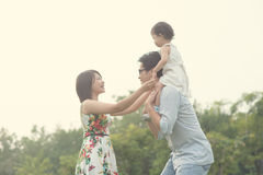 Asian family playing and enjoying. Quality time outdoor , vintage tone Royalty Free Stock Image