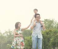 Asian family playing and enjoying. Quality time outdoor , vintage tone Royalty Free Stock Photo