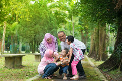 Asian family playing outdoor. Family playing at outdoor garden park. Happy Southeast Asian people living lifestyle royalty free stock photo