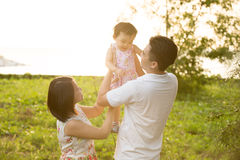 Asian family playing at outdoor park Stock Images