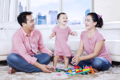 Asian family plays with toys in the apartment Royalty Free Stock Photo