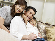 Asian family. Portrait of an asian family of three Royalty Free Stock Image