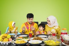 Asian family praying before their break fast stock image