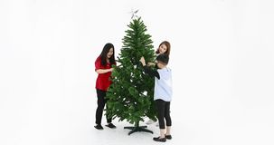 Asian family preparing Christmas tree. Lovely Asian family preparing Christmas tree to ready for decorated by ornament together, son walk around Christmas tree stock video footage