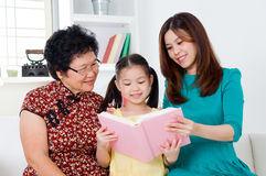 Asian family reading Stock Photos