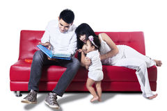 Asian family reading story Royalty Free Stock Photography