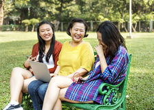 Asian Family Relaxing Lifestyle Concept Stock Photos