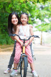 Asian family riding bike Royalty Free Stock Images