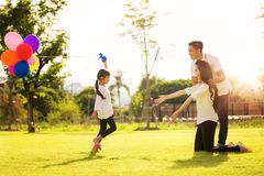 Asian family run and play in a garden Stock Image