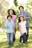 Asian family running in park Stock Photo
