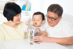 Asian family saving coins Royalty Free Stock Photo