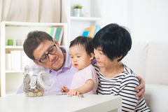 Asian family saving money indoor Stock Photos