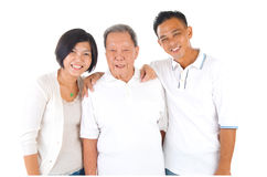 Asian family. Senior men with his daughter and son. Happy Asian family senior father and adult offspring indoor portrait royalty free stock photo
