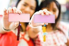 Asian family show mark wood Royalty Free Stock Photo
