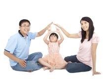 Asian family showing home sign Royalty Free Stock Photo