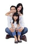 Asian family sit in the studio Stock Photos