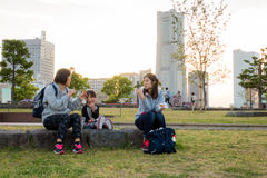 Asian family is sitting in Yokohama park. Stock Photography
