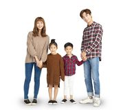 family smiling and standing together stock photography