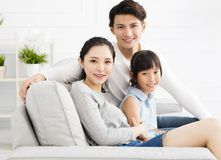 Asian family on sofa in living room Stock Image