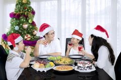 Asian family speaking each other at Christmas dinner. Image of Asian family speaking each other while having Christmas dinner at home Stock Images