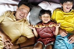 Asian family spending time together on holiday stock photos