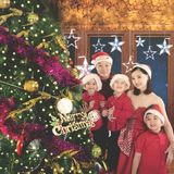 Asian family standing near a Christmas tree. Picture of Asian family smiling at the camera while standing near a Christmas tree. Shot at home royalty free stock images