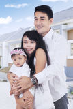 Asian family standing at new residential Royalty Free Stock Photo