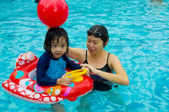 Asian family. In swim tube playing on swimming pool Stock Images