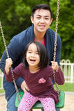 Asian family on a swing Stock Photo