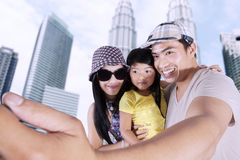Asian family taking selfie photo Stock Photo