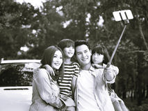 Asian family taking a selfie during trip royalty free stock photography
