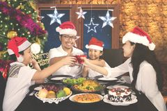 Asian family is toast together in dining table Royalty Free Stock Photo