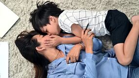 Asian family togetherness at home. Mom and kid playing in living room. Lifestyle and family activity