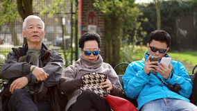 Asian family travel together. Son is connect internet looking fo Royalty Free Stock Photo