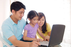 Asian family. Using laptop at home Stock Photography
